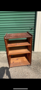 Solid wood roll around cart with 3 spaces + the top shelf for Tv - $20 obo in The Woodlands, Texas