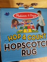 Melissa and doug hopscotch rug new in box in Naperville, Illinois