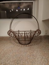 Large wrought iron wall hanging basket in Westmont, Illinois