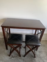 Bar dark wood with two leather top stools in Fort Knox, Kentucky