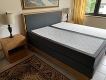Bed - 180x200cm, includes headboard, frame, box springs, mattresses, topper, nightstands, and lamps in Ramstein, Germany