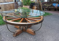 gorgeous hand made coffee table with antique wheel and horse shoes in Stuttgart, GE