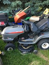2 complete Craftsman tractors 1 snow plow and 1 double bagger for repair or parts. in Yorkville, Illinois