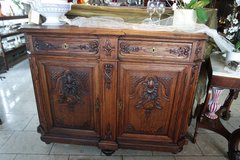 elegant tiger oak buffet with ornate carvings in Stuttgart, GE