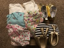Baby onesies and shoes in Fort Benning, Georgia