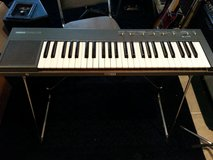 Keyboard- Vintage Yamaha PSR-15 keyboard complete with stand and AC adapter in Macon, Georgia