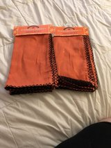 2 new packages of orange napkins in Chicago, Illinois