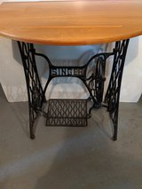 Singer Treadle sewing machine base with wood top in Orland Park, Illinois