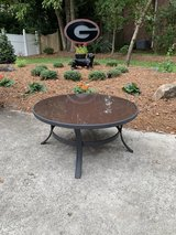 Wrought iron and glass coffee table in Macon, Georgia