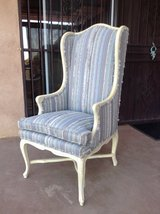 Wing chair in antique finished solid wood frame by Stone &Phillips in Yucca Valley, California