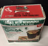Safari Qwik-Cook Round Tailgate Portable BBQ Grill Uses Newspaper in Naperville, Illinois