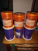 Spools of purple & orange metallic  ribbon in Chicago, Illinois