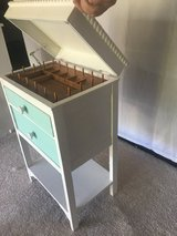 Sewing cabinet used as a night stand in Naperville, Illinois