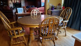 Oak dining table in Joliet, Illinois