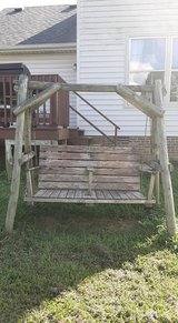 Rustic wood outdoor swing in Clarksville, Tennessee