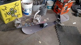 2 snowboards with boots and pants in Alamogordo, New Mexico