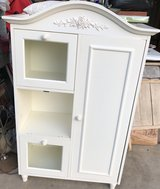 White Cabinet with Floral Trim in Sandwich, Illinois