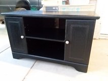 black wooden entertainment center in Yucca Valley, California