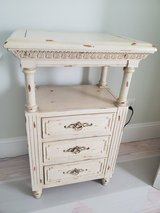 Distressed side table with hidden drawer in Beaufort, South Carolina