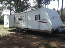2009 surveyor by Forest River 32 foot bumper pull with double slide outs i in Spring, Texas