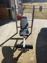 Weight bench with weights in Fort Polk, Louisiana