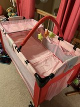 Baby folding play pen with changing table and bassinet in Orland Park, Illinois