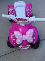 Minnie mouse four wheeler with charger in Beaufort, South Carolina