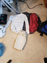 3 longsleeve small shirts and 28X30 tan jeans in Greenville, North Carolina