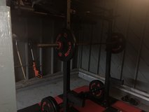 Squat rack, barbell with 2x 45 plates, 25, 10 bumper. Bowflex adjustable dumbbells and perfect p... in Fort Campbell, Kentucky