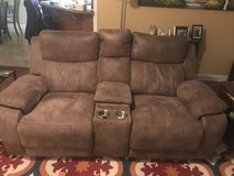 Reclining sofa with console and cupholders in Fort Campbell, Kentucky