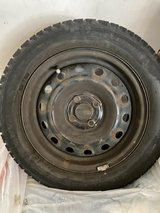 Set of 4 Cooper snow tires mounted on wheels in Joliet, Illinois