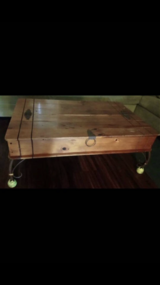 Wood coffee table with storage inside in Camp Pendleton, California