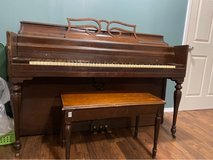 Antique piano with bench in Fort Leonard Wood, Missouri
