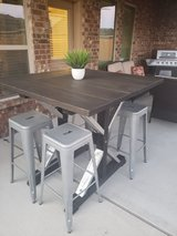 Table with barstools in Houston, Texas