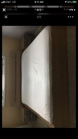 ikea king bed with comforter and mattress in Joliet, Illinois