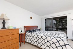 Wood bed frame, queen mattress and box spring, dresser and bedside table in San Diego, California