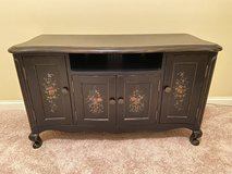 Black TV Console with floral design in Joliet, Illinois