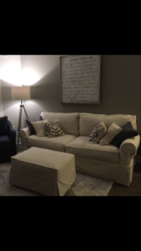 Off White Slipcover Couch and Ottoman. in Bolingbrook, Illinois