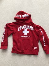 """Red """"Lifeguard"""" hooded sweatshirt in Chicago, Illinois"""
