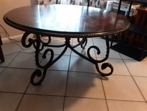 a beautiful round table  with alsome iron leg in Kingwood, Texas