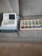 Cash register and money for children's play in Joliet, Illinois