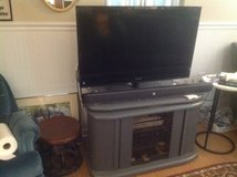 TV and stand in Bolingbrook, Illinois