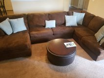 Chocolate suede like sectional couch w/pillow & ottoman in Macon, Georgia