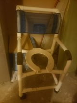 Shower rolling chair and sliding board in Kingwood, Texas