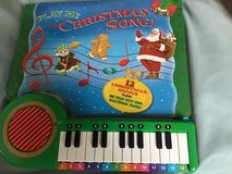 Play me Christmas. Song book and piano in Chicago, Illinois