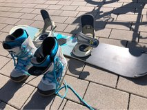 Snowboard with Boots in Kansas City, Missouri