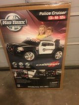 Kids double passenger police car in Fort Campbell, Kentucky