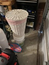 Pink and white laundry basket in Baytown, Texas