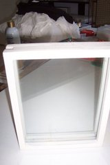 wood and glass sand and frame box in Conroe, Texas