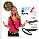 Shot glass bandolier, belt, serving tray, and shot glasses with lids in Alamogordo, New Mexico